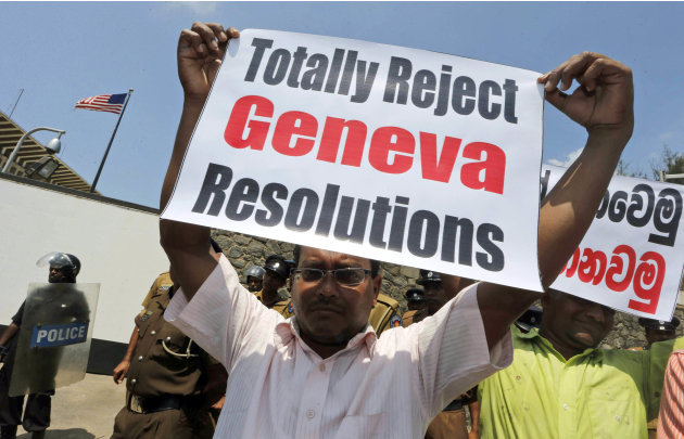 A Sri Lankan government supporter holds a placard during a protest outside the U.S. Embassy against a United States-sponsored draft resolution discussed at the United Nations Human Rights Council in G