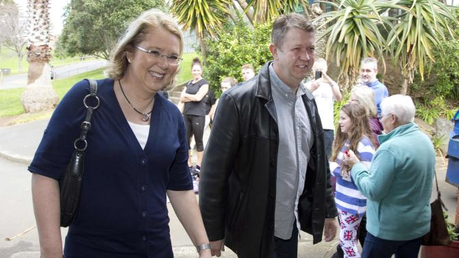 New Zealand's Labour Party leader David Cunliffe arrives to watch a water polo game with his wife Karen Price on election day during New Zealand's general election in Auckland