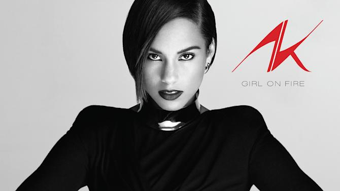 """This CD cover image provided by RCA Records shows the latest release by Alicia Keys, """"Girl on Fire."""" It's her first release after her marriage to producer-rapper Swizz Beatz and the birth of their son Egypt. (AP Photo/RCA Records)"""