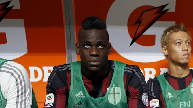 AC Milan's Balotelli sits on the bench before their Serie A soccer match against Empoli in Milan