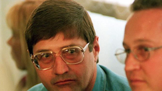FILE - This file photo taken Sept. 14, 1998, shows police death squad leader, Eugene de Kock, who was sentenced to two life terms and more than 200 years, after a killing spree that cost dozens of lives, at an amnesty hearing of the Truth and Reconcilliation Commision (TRC) in Pretoria, South Africa. After 20 years in jail, de Kock says he is the only member of the former police force serving time for crimes committed on behalf of South Africa's old order and maintains he acted on instructions from leaders who were never punished. (AP Photo/Denis Farrell, File)