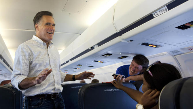 FILE - In this June 18, 2012 file photo, Republican presidential candidate, former Massachusetts Gov. Mitt Romney talks with the media aboard his plane at an airport in Moline, Ill. With the presidential campaign entering a six-week period before the national nominating conventions kick off the fall campaign, how Romney takes advantage of his assets and seeks to overcome his hurdles against President Barack Obama will partly determine whether heís able before then to break out of what polls show is a close race. (AP Photo/Evan Vucci, File)