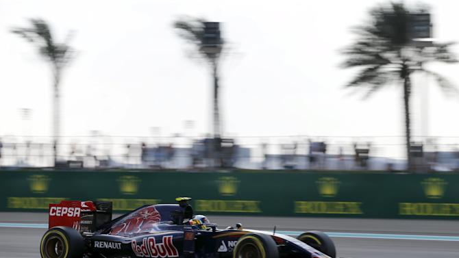 Toro Rosso Formula One driver Carlos Sainz of Spain drives during the third free practice session of Abu Dhabi F1 Grand Prix at the Yas Marina circuit in Abu Dhabi