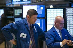 Traders react as they watch their screens shortly after the open of trading on the floor of the New York Stock Exchange, September 23, 2013. REUTERS/Lucas Jackson