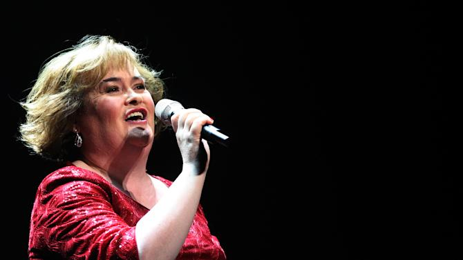 """FILE - In this March 27, 2012 file photo, Susan Boyle performs during her musical 'I Dreamed A Dream' at the Theatre Royal in Newcastle, England. Boyle is making her big-screen acting debut in a Christmas-themed British period drama. The Scottish singer appears in """"The Christmas Candle,"""" a story of angels and wishes set in an English village in the 1890s. (AP Photo/Scott Heppell, File)"""