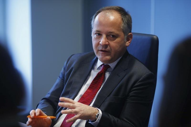 Coeure says ECB weighing how best to act, France wants policy shift