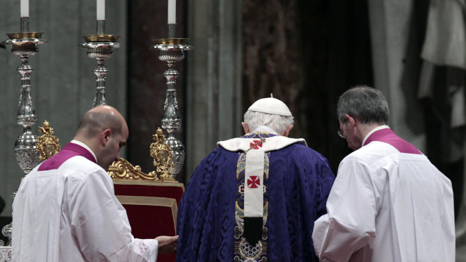 "Pope Benedict XVI is helped by master of ceremonies to walk on the altar as he celebrates the Ash Wednesday mass in St. Peter's Basilica at the Vatican, Wednesday, Feb. 13, 2013.  Ash Wednesday marks the beginning of Lent, a solemn period of 40 days of prayer and self-denial leading up to Easter. Pope Benedict XVI told thousands of faithful Wednesday that he was resigning for ""the good of the church"", an extraordinary scene of a pope explaining himself to his flock that unfolded in his first appearance since dropping the bombshell announcement. (AP Photo/Gregorio Borgia)"