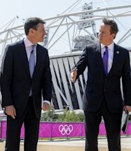 <p>British Prime Minister David Cameron (right) speaks to London Olympics organiser Sebastian Coe in front of the main Olympic stadium in east London. Cameron has declared security his main concern on the eve of the Olympics, while US presidential hopeful Mitt Romney backtracked on unflattering comments he made.</p>