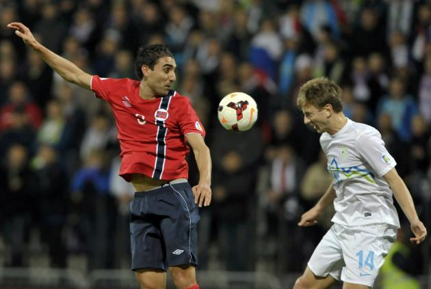 Slovenia's Mertelj and Norway's Bjordal jump for the ball during their World Cup 2014 qualifier soccer match in Maribor