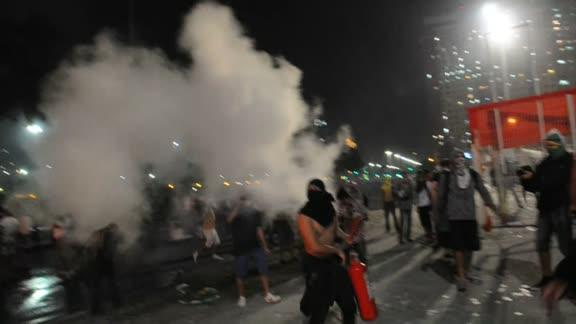 Riot police clash with protesters in Rio street battles