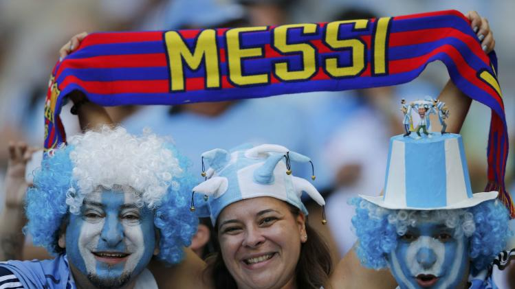 Fans of Argentina wait for the start of the 2014 World Cup Group F soccer match against Iran at the Mineirao stadium in Belo Horizonte