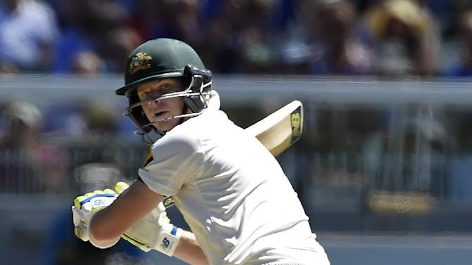 Australia's captain Steve Smith watches the ball after making a shot against India during the second day of their cricket test match in Melbourne, Australia, Saturday, Dec. 27, 2014. (AP Photo/Andy Brownbill)