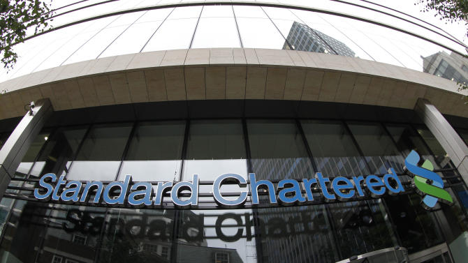 """A sign of Standard Chartered bank is seen at its headquarter in the City of London, Tuesday, Aug. 7, 2012. Shares in Standard Chartered PLC dropped sharply on Tuesday as investors reacted to U.S. charges that the bank was involved in laundering money for Iran. The charges against Standard Chartered were a shock for a bank which proudly described itself recently as """"boring.""""  (AP Photo/Sang Tan)"""