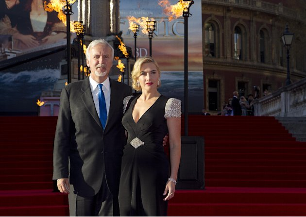 Director James Cameron, left, and actress Kate Winslet arrive at the 'Titanic 3D' UK film premiere at the Royal Albert Hall in Kensington, West London, Tuesday, March 27, 2012. The re-launch of the Ti