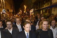 New Flemish Alliance party leader Bart de Wever (C) walks with party members Koen Kennis (L) and Liesbeth Homans (R) to the town hall in Antwerp after being voted in as mayor during local elections. After his win De Wever immediately urged Belgian Prime Minister Elio Di Rupo to radically re-shape the federal state