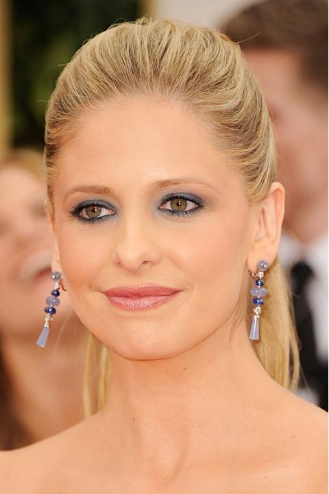 MISS: Sarah Michelle Gellar's make-up would be bad for a junior prom, let alone a high-stakes awards show red carpet. The 1980's blue eye make-up and iridescent lip gloss really slays me (pun intended