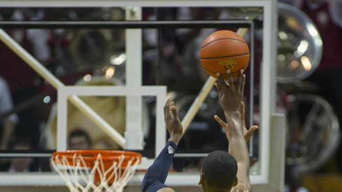 Indiana's Jeremy Hollowell (33) tries to block the 3-point shot of Michigan's Glenn Robinson III (1) during the second half of an NCAA college basketball game Saturday, Feb. 2, 2013, in Bloomington, Ind. Indiana defeated Michigan 81-73. (AP Photo/Doug McSchooler)