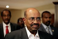 <p>Sudan's President Omar al-Bashir walks in a hotel in Addis Ababa on September 24 where he met with his South Sudanese counterpart Salva Kiir. Marathon efforts to strike a deal between rival neighbours Sudan and South Sudan stretched late into the night Wednesday, as earlier optimism that an agreement would be signed appeared to fade.</p>
