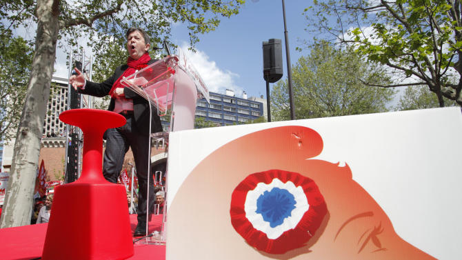 Leader of the French leftist party, Jean Luc Melenchon, delivers a speech before a rally to protest against the austerity measures announced by the French government, in Paris, Sunday, May 5, 2012. (AP Photo/Michel Spingler)
