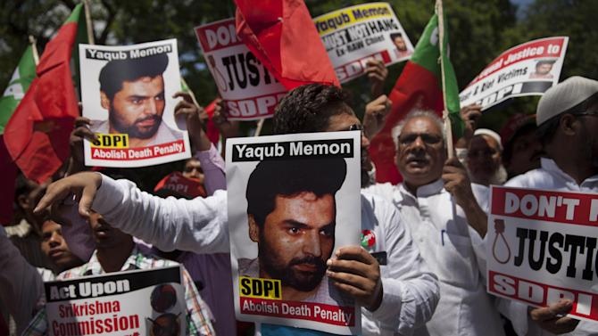 Social Democratic Party of India (SDPI) activists carry placards with photographs of 1993 Mumbai blasts convict Yakub Memon during a protest outside the Maharashtra House demanding abolition of death penalty in New Delhi, India, Monday, July 27, 2015. Yakub Memon who is currently at the Nagpur Central Prison in western Maharashtra state is facing possible hanging to death on July 30 if the Supreme Court dismisses his mercy petition. (AP Photo/Tsering Topgyal)