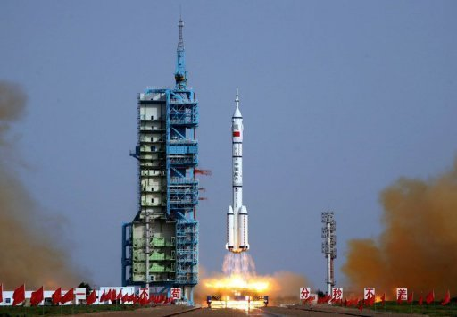 <p>The Shenzhou-9 spacecraft takes off from the Gobi desert on June 16. China completed its first automatic space docking on a manned mission Monday, before the three astronauts on board enter an orbiting module -- a key step towards the nation's first space station.</p>