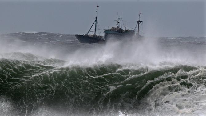 A Chinese fishing boat navigates through rough waves caused by Typhoon Bolaven in waters off Seogwipo on Jeju Island, South Korea, Monday, Aug. 27, 2012.  (AP Photo/Yonhap, Kim Ho-cheon) KOREA OUT