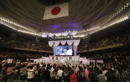 FILE - In this June 6, 2012 file photo, an image of Japans all-girl pop idol group AKB48 member Yuko Oshima waving at fans is shown on the screen after she won the annual AKB48 popularity poll in Tokyo. More than 60 girls and young women, split into four teams, make up what is arguably Japan&#39;s most popular pop group. It performs almost every day, has spawned affiliate groups across the country and has recently given rise to sister mega-groups in China and Indonesia. (AP Photo/Shizuo Kambayashi, File)