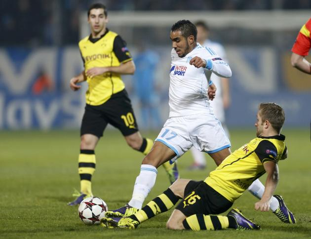 Olympique Marseille's Payet challenges Borussia Dortmund's Blaszczykowski and Mkhitaryan during their Champions League soccer match in Marseille