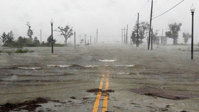 Isaac's winds and storm surge flood parts of Waveland, Miss., Wednesday, Aug. 29, 2012, the seventh  anniversary of Hurricane Katrina hitting the Gulf Coast.  (AP Photo/Rogelio V. Solis)