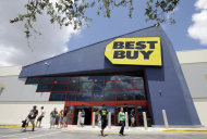 <p> In this Monday, Aug. 19, 2013 photo, shoppers walk toward the parking lot at a Best Buy store in Hialeah, Fla. On Tuesday, Aug. 20, 2013, Best Buy releases quarterly financial results. (AP Photo/Alan Diaz)