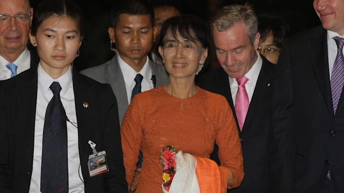 Myanmar opposition leader Aung San Suu Kyi  arrives at hotel in Bangkok on Tuesday May 29, 2012. For 24 years, Aung San Suu Kyi was either under house arrest or too fearful that if she left Myanmar, the government would never let her return. Now, in a sign of how much life there has changed, she's back to being a world traveler.(AP Photo/Sakchai Lalit)