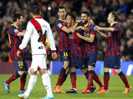 Barcelona's Messi, Busquets, Adriano, Fabregas and Iniesta celebrate a goal against Rayo Vallecano during their Spanish first division soccer match in Barcelona