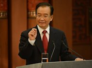 Chinese Premier Wen Jiabao (pictured in August) meets Europe&#39;s leaders on Thursday as the world&#39;s second-biggest economy falters in the eurozone debt crisis downdraft and the two sides face a long list of trade disputes