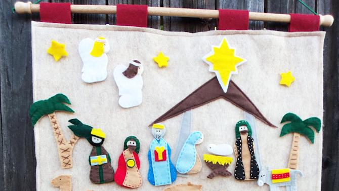 "This undated publicity photo provided by Jessica Anderson shows a carefully cut out and sewed nativity scene that tells the story of Jesus'  birth which Anderson, of Rancho Cordova, Calif., made to teach her three young children. She's convinced advent calendars promote family bonding. ""I feel with the advent calendar, it's something they will remember when they grow up,"" says Anderson, who blogs at Cutesy Crafts. (AP Photo/Jessica Anderson, Jessica Anderson)"