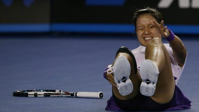 China's Li Na falls for a second time during her match against Victoria Azarenka of Belarus in the women's final at the Australian Open tennis championship in Melbourne, Australia, Saturday, Jan. 26, 2013. (AP Photo/Aaron Favila)