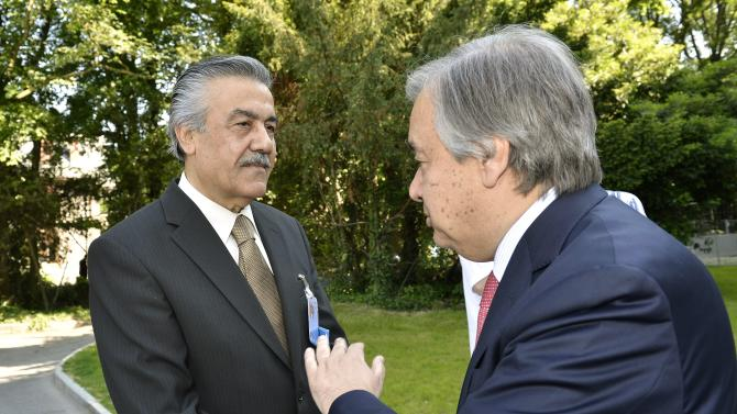 Faysal Khabbaz Hamoui, left, Ambassador of the Permanent Representative Mission of Syria to Geneva speaks with Antonio Guterres, right, United Nations High Commissioner for Refugees, prior to a meeting for the launch of the Regional Response Plan for Syrian Refugees and Syrian Humanitarian Assistance Response Plan, at the World Trade Organisation, WTO, headquarters in Geneva, Switzerland, Friday, June 7, 2013. (AP Photo/Keystone, Martial Trezzini)