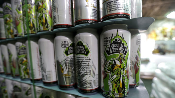 A stack of cans of the MechaHopzilla brand beer sit waiting to be filled at the NOLA Brewing Co. in New Orleans, Tuesday, Sept. 10, 2013. The Japanese company that produced the classic Godzilla series of movies has sued the New Orleans brewery, claiming the MechaHopzilla beer brand infringes on its Mechagodzilla copyrights and trademarks. (AP Photo/Gerald Herbert)