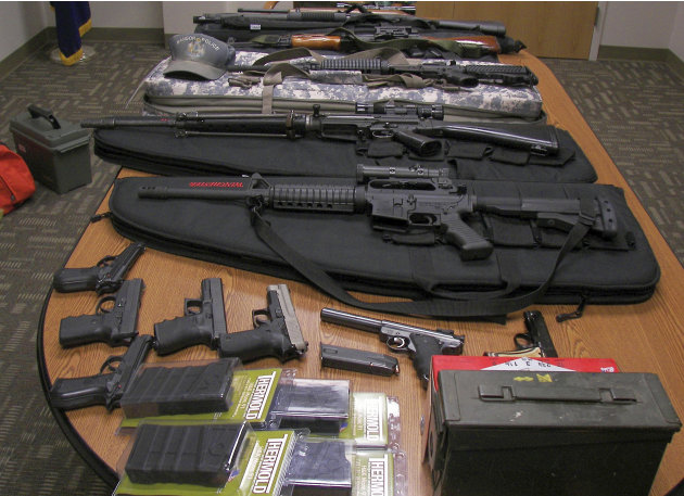 This undated photograph released by the Maine State Police shows weapons gathered from the home and vehicle of Timothy Courtois, of Biddeford, Maine, who was arrested Sunday, July 22, 2012 on charges