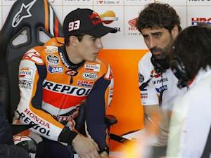 Honda MotoGP rider Marc Marquez of Spain listens to technicians before the first free practice session ahead the Valencia Motorcycle Grand Prix at the Ricardo Tormo racetrack in Cheste, near Valencia