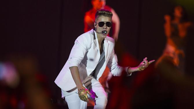 "FILE - A Sunday, March 31, 2013 photo from files showing Canadian singer Justin Bieber performing on stage during the ""I Believe Tour "" in Berlin, Germany. Swedish police say they have found drugs on board a tour bus used by Canadian pop singer Justin Bieber. Police spokesman Lars Bystrom says a small amount of drugs and a stun gun were found when officers raided the empty bus parked under the Globen concert venue in Stockholm, where Bieber was performing Wednesday, April 24, 2013. (AP Photo/Gero Breloer)"
