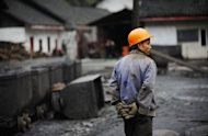 A worker walks through a mine in Sichuan in 2009. A gas explosion at a coal mine in southwest China has trapped 50 miners underground, state media said Wednesday, in the latest mining disaster to hit the country