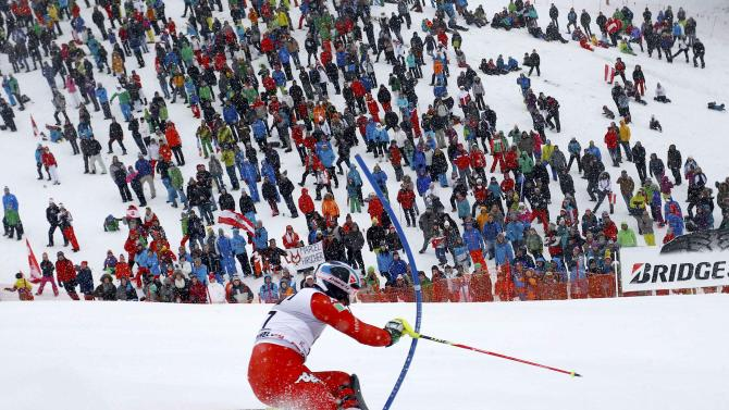 Deville of Italy competes during men's Alpine Skiing World Cup slalom in Kitzbuehel