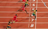 Usain Bolt Takes 100-Metre Gold