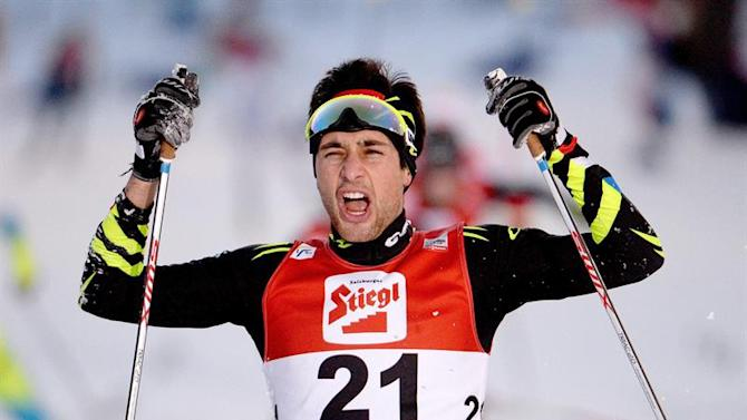 APA21744336. Ramsau Am Dachstein (Austria), 21/12/2014.- Jason Lamy Chappuis (FRA/1st) celebrates after crossing the finish line at the FIS Nordic Combined World Cup in Ramsau am Dachstein, Austria, 21 December 2014. EFE/EPA/ROLAND SCHLAGER