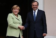 &lt;p&gt;Greece&#39;s Prime Minister Antonis Samaras (R) and Germany&#39;s Chancellor Angela Merkel shake hands at the Maximos mansion in Athens, on October 9. Efforts to restore investor confidence in Greece&#39;s struggling economy took a double blow this week when a major European bottler and a prominent dairy company announced relocation plans.&lt;/p&gt;