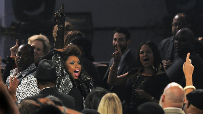 """Singer Jennifer Hudson wades into the audience at """"We Will Always Love You: A Grammy Salute to Whitney Houston,"""" at Nokia Theatre on Thursday, Oct. 11, 2012, in Los Angeles. The one-hour concert tribute will air on CBS on Nov. 16. (Photo by Chris Pizzello/Invision/AP)"""