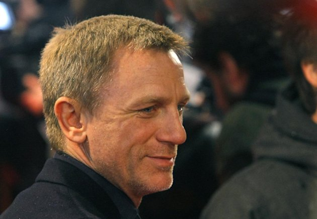 "Actor Daniel Craig attends the premiere of ""The Girl With The Dragon Tattoo"" at the UGC Normandie movie theater, in Paris, Tuesday, Jan. 3, 2012. (AP Photo/Jacques Brinon)"