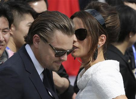 British actress Beckinsale speaks with actor DiCaprio of the U.S. at the launch ceremony of Qingdao Oriental Movie Metropolis on the outskirts of Qingdao