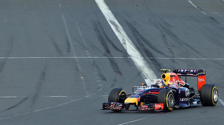 Red Bull driver Daniel Ricciardo takes a turn at the start of the Formula One Australian Grand Prix in Melbourne on March 16, 2014