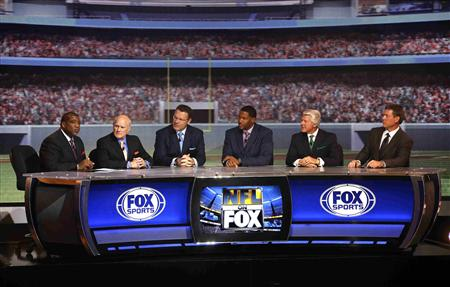 "Members of the Fox NFL Sunday broadcast team appear during a presentation to announce Fox's new sports network ""Fox Sports 1"" in New York"